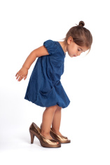 stock-photo-71963997-cute-little-girl-with-big-high-heel-shoes