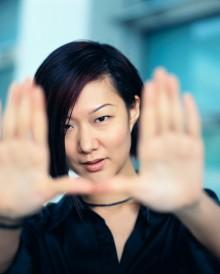 Woman Framing with Hands ca. 2002 Hong Kong, China